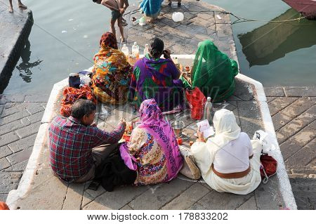 People Performs Morning Pooja On Sacred River Narmada