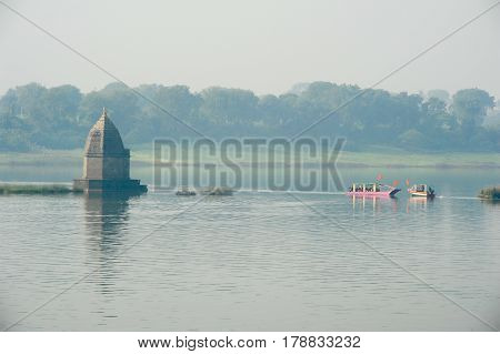 Maheshwar, India - 3 February 2015: Boats on the sacred river Narmada at Maheshwar on India