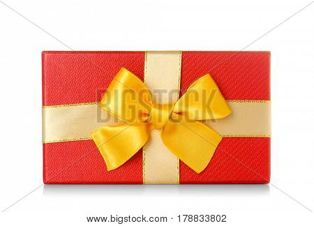 Beautiful red gift box with golden ribbon on white background