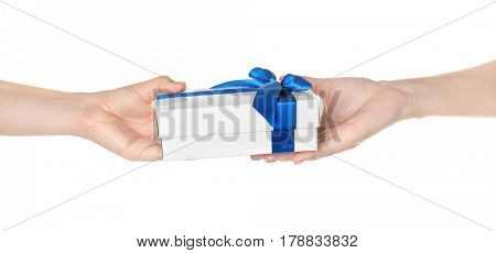 Hands giving and receiving gift box on white background