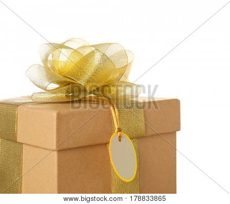 Beautiful gift box with golden ribbon and blank label on white background