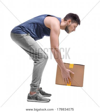 Posture concept. Man lifting heavy cardboard box against white background