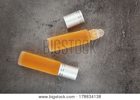 Bottles with perfume on grunge background