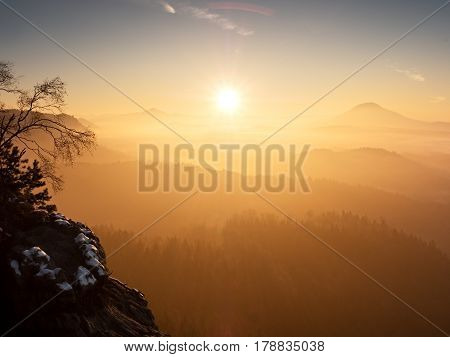 Misty Daybreak In A Beautiful Hills. Gradation Of Colorful Clouds.