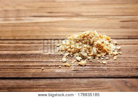 Heap of breadcrumbs on wooden table