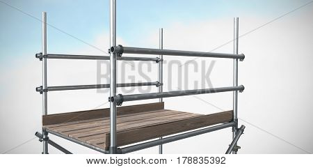 3d image of scaffolding against blue sky with clouds