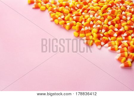 Tasty Halloween candies on light color background