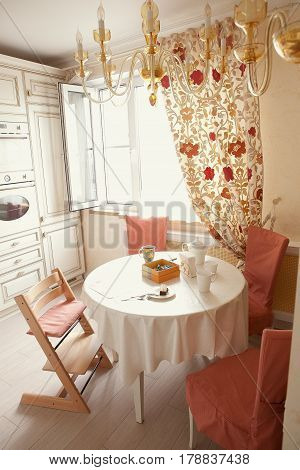 apartment flat kitchen in ivory color close up photo