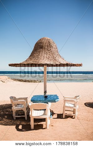 Vacation Holidays. Three Beach Lounge Chairs Under Tent On Beach.