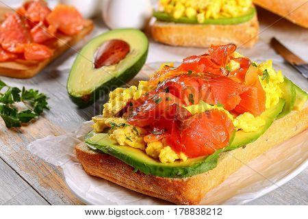 Sandwich With Salmon, Avocado, Scrambled Eggs