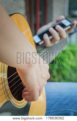 Guitarist Hand Playing Acoustic Guitar stock photo