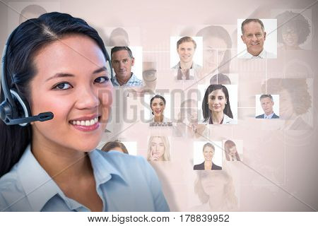 Smiling businesswoman using headset against neutral background