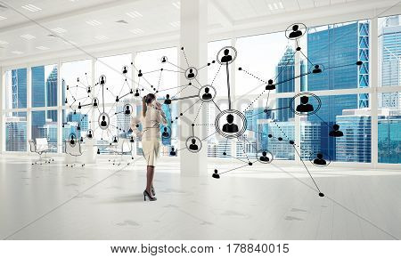 Elegant businesswoman in modern office talking mobile phone and social connection concept. Mixed media
