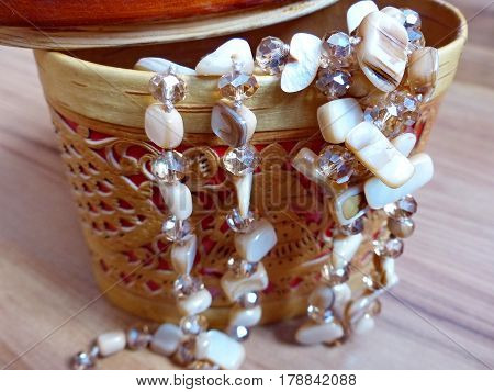 Beads made of natural stone in a casket from birch bark. Closeup. Ural gems. Ural, Russia