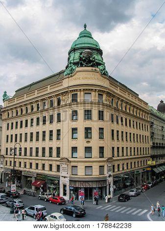 VIENNA AUSTRIA - JUNE 20 2003: Riunione Adriatica di Sicurta insurance company building on Albertinaplatz built in 1911 by Ludwig Baumann in Vienna Austria - June 20 2003.