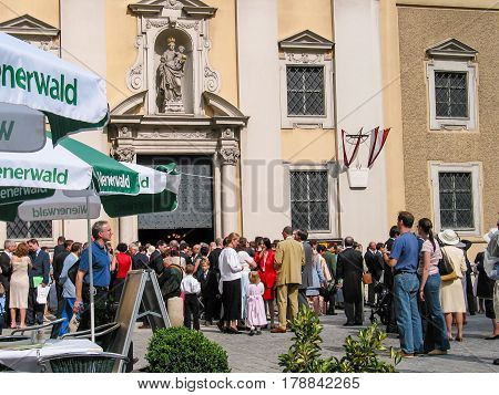 VIENNA AUSTRIA - JUNE 21 2003: Guests meet at wedding ceremony near the church in Vienna Austria - June 21 2003.