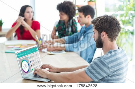 Casual businessman typing on his laptop against graphic image of bank account web site
