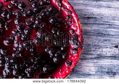 Cheesecake With Currant On Color Wooden Background. Top View. Copy Space.