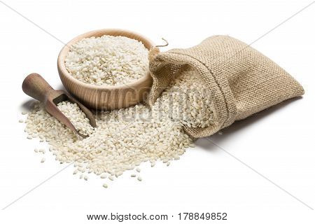 white rice in wooden bowl and juta bag on white background