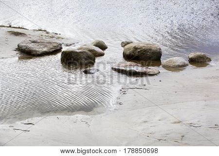 Boulders in the water to reach the other side