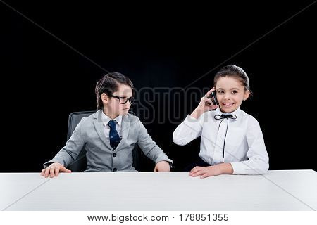 Boy In Eyeglasses And Suit Looking At Girl Talking On Smartphone