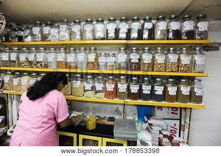 Saleswoman On A Spices Shop Of Mumbai