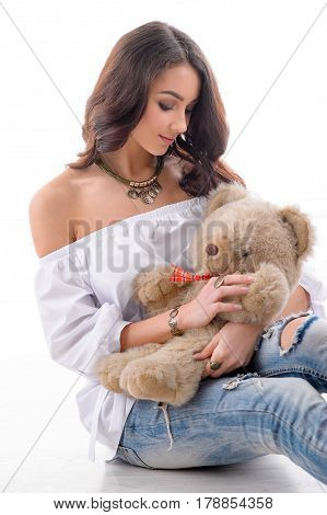 fashion woman model with toy wearing luxury silver accessory and jewelry. Girl portrait on white background