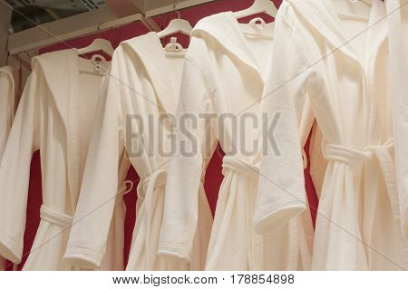 White terry robes in the closet on the trembler