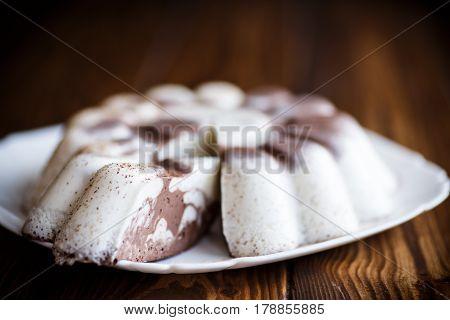 sweet milk chocolate panna cotta on black background