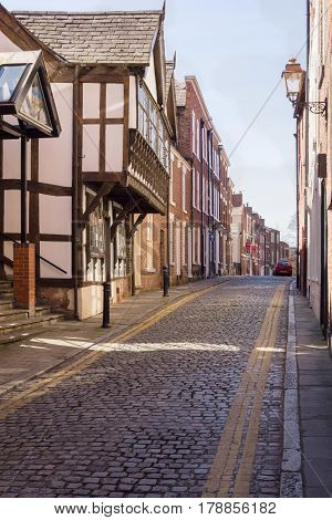 Chester England UK - March 25 2017: White Friars lane in Chester with its traditional cobble stone paving and mix of Georgian and Medieval style terraced residential and business properties