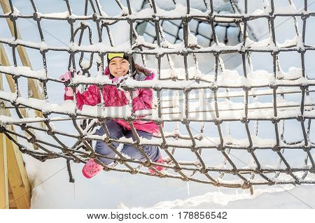 Little girl playing on a playground at the National Park Durmitor Montenegro