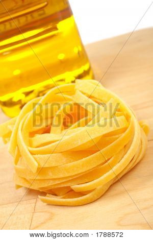Uncooked Pasta Nest And Oil