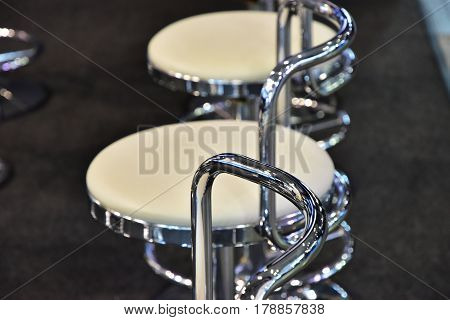 Round chair in the room and spectacle of metal