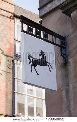 Chester England UK - March 25 2017: Lloyds sign with its familiar prancing black horse logo outside a high street branch. Lloyds is largest retail bank in the United Kingdom with over 16 million customers and was founded in 1765
