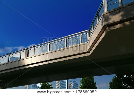 Blue sky of a city and a pedestrian overpass