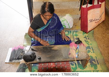 Woman Manufacturing Incense Sticks On A Fabric At Mysore