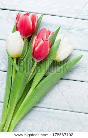 Colorful tulips over wooden background. Easter card