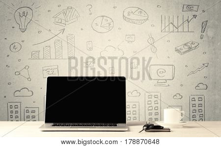 An open laptop on a white office desk with flower, coffee, books in front of wall background full of financial business charts concept