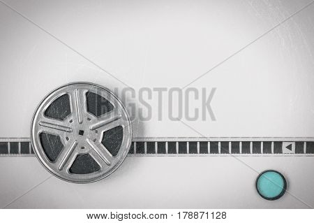 The metal coil with the film and the blue filter are on a gray background.
