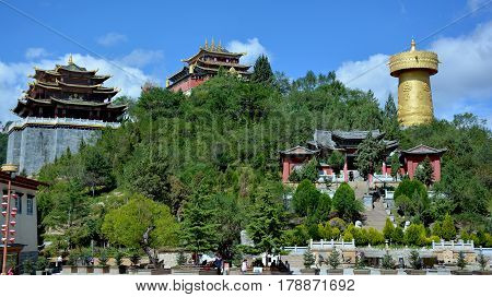 Shangri-la central square Guishan Si temple and biggest buddhist wheel in the world Yunnan province China.