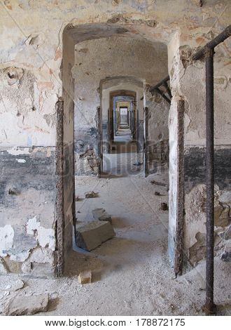 Endless Doors In Vintage Old Ruined Building With Damaged Plaster Walls