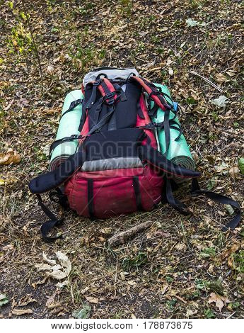 close-up of the tourist backpack lying at the ground