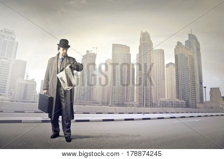Businessman standing with city in the background