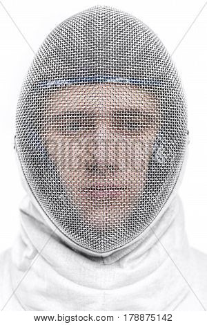 Close-up View Of Young Man Professional Fencer Wearing Helmet