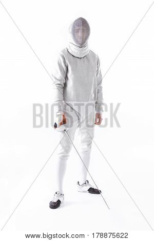 Serious Fencer In Uniform Holding Rapier In Hand On White