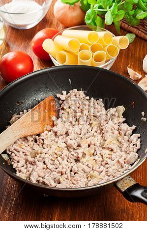 Minced Meat Fried With Onions And Garlic In The Frying Pan. Preparation Cannelloni