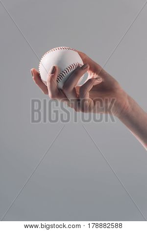 Close-up Partial View Of Young Woman Holding Baseball Ball On Grey