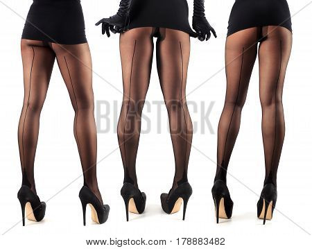 Sexy female legs in beautiful stylish stockings and high heels shoes black gloves and dress isolated on white background