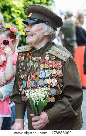 UKRAINE KIEV MAY 9 2016 Victory Day May 9. Monument to an unknown soldier: Veterans of World War II carry flowers to the monument of an unknown soldier