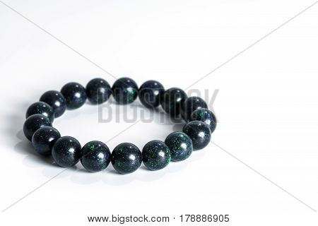 Beautiful rare Black Opal beads in bracelet on white background